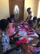 Seamstresses assembling 300 menstrual pad kits