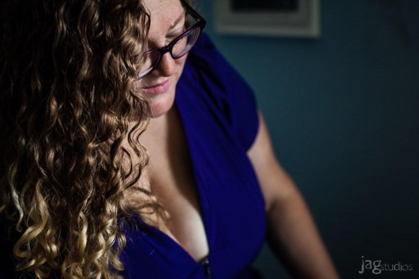 Boudoir photography of Woman in blue shirt JAGstudios