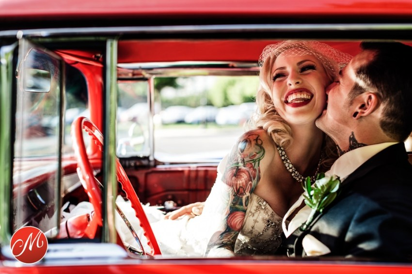bride and groom in hotrod car