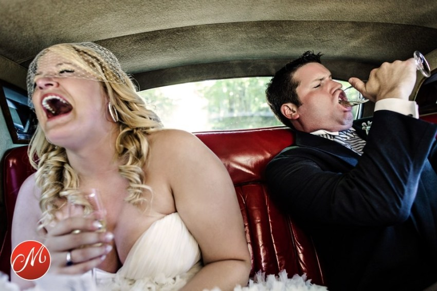 groom and bride joking around in back seat of car
