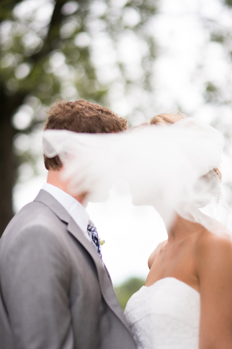 couple-wedding-portraits-green-blue-veil