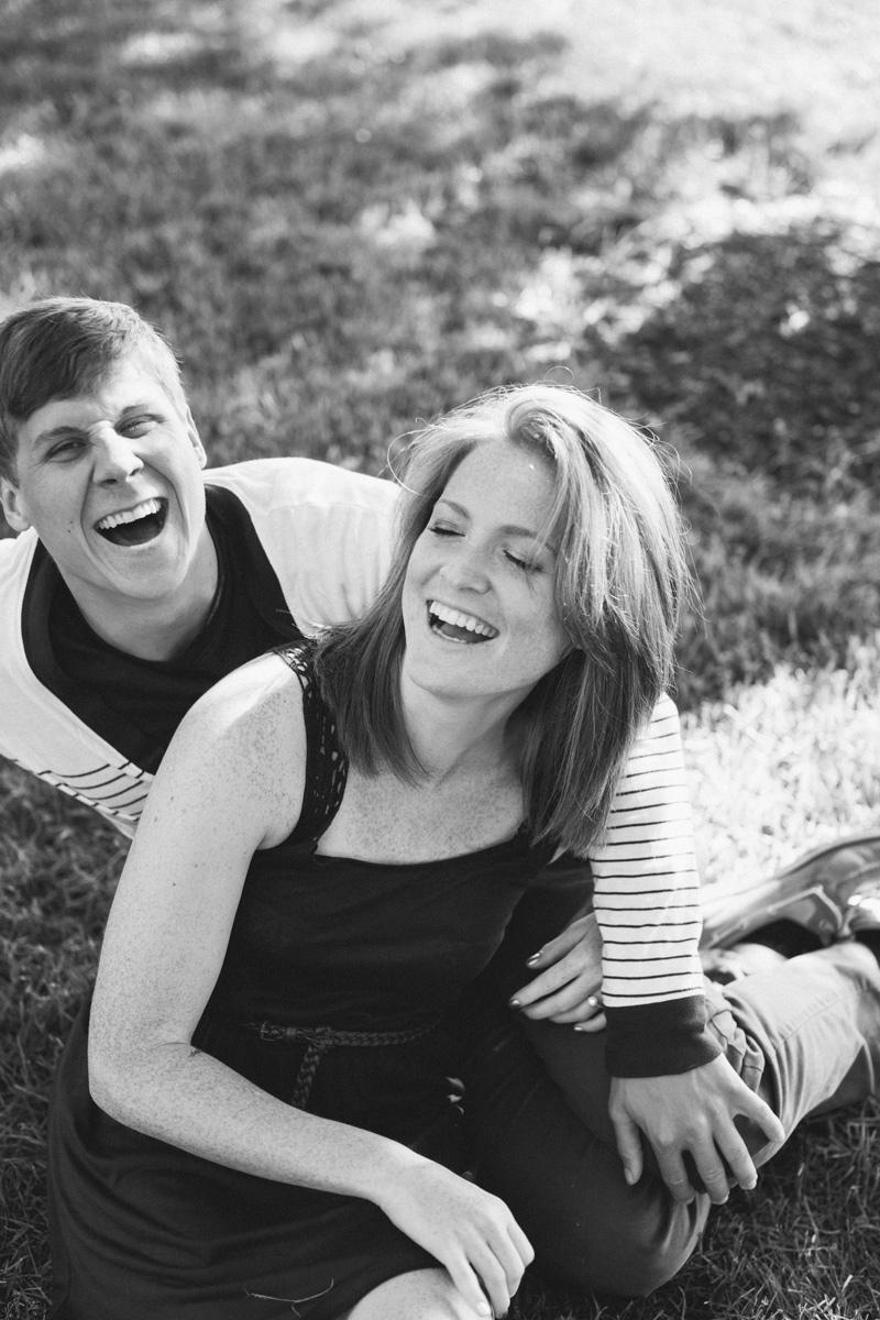 couple laughing engagement photos lifestyle