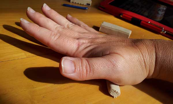 rolling-clay-with-hand
