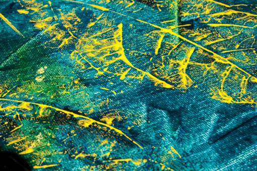 details of Abstract leaves painting. Turquoise background with yellow leaves.