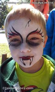 boy with vampire face paint