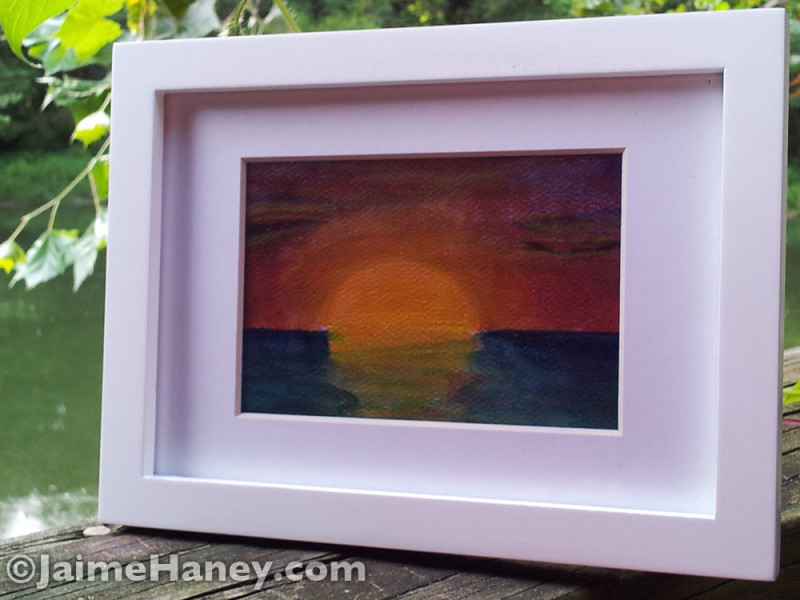 Sunset study shown in white mat and frame