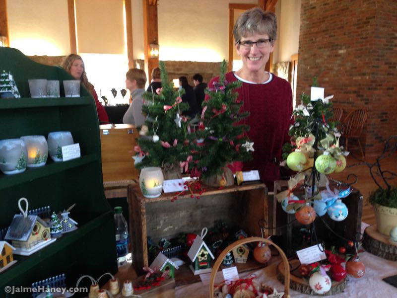 Patricia K. Beagle in front of her booth at Christmas in New Harmony