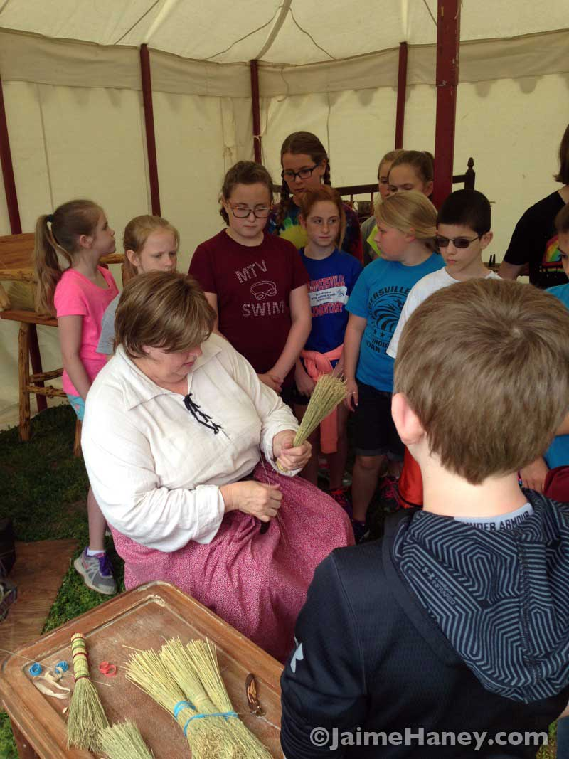 children watching Claudie Parson demonstrate broom making at the Heritage Artisans Days in New Harmony Indiana 2016