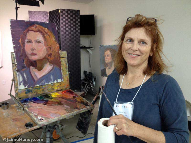 Artist Diane May with her finished painting