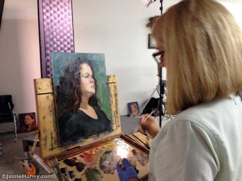 Laura Shepard adding finishing touches to her painting