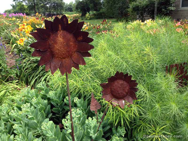 rusted metal sunflower garden art