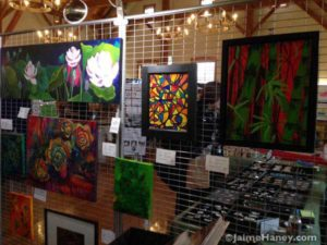 Paintings in the art booth of Jaime Haney at Christmas in New Harmony.