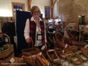 The basket weaver in her booth at Christmas in New Harmony upstairs at the Rapp-Owen Granary.