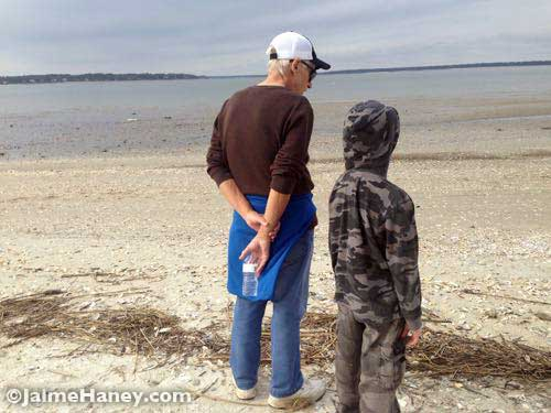 My dad and son checking out the seashore.