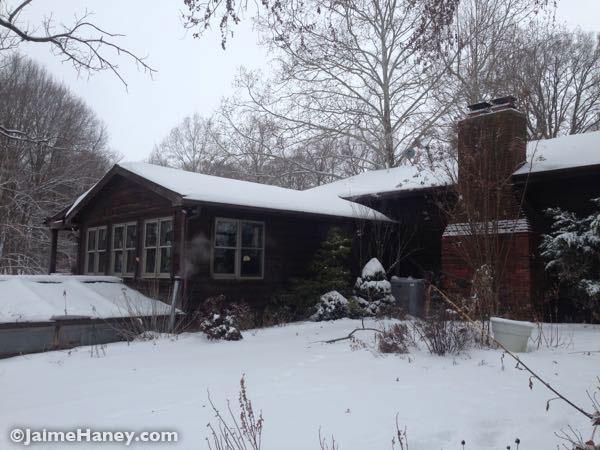 cedar house in the snow