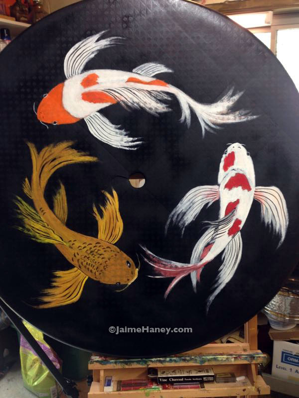 finished painted koi fish on upcycled plastic patio table top