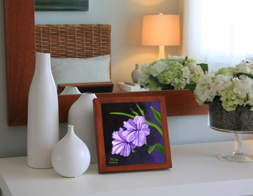 Purple Mexican petunia painting shown in wood frame on dresser.