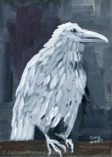 white raven painting on log