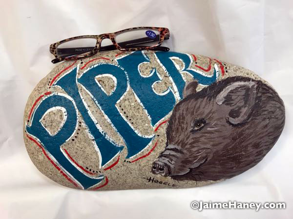 Commissioned artwork of a pig painted on a rock