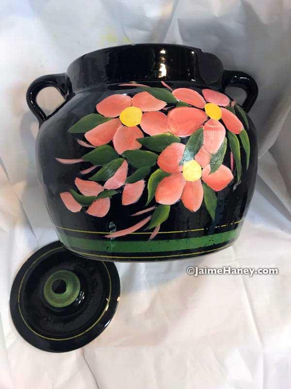 refurbished black McCoy cookie jar with peach flowers