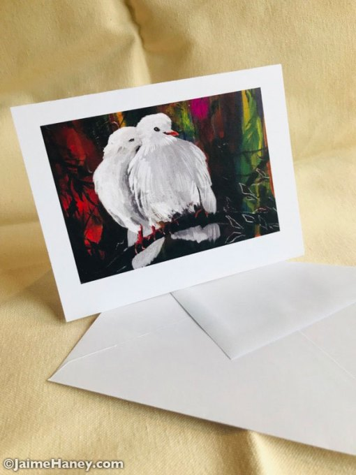 A single note card with a painting of two white doves and envolpe by Jaime Haney.