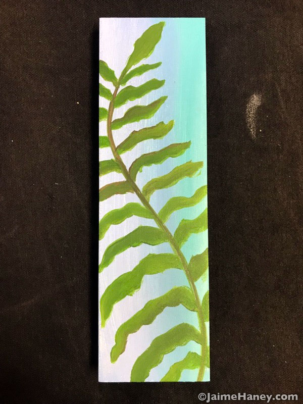 fern frond painted on wood