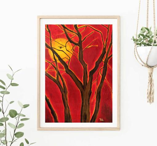 Art print of original painting of the blazing sun and a tree with a soaring bird shown in frame on wall.