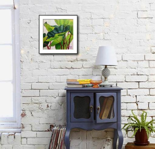 elephant ears plant painting shown matted and framed on a wall