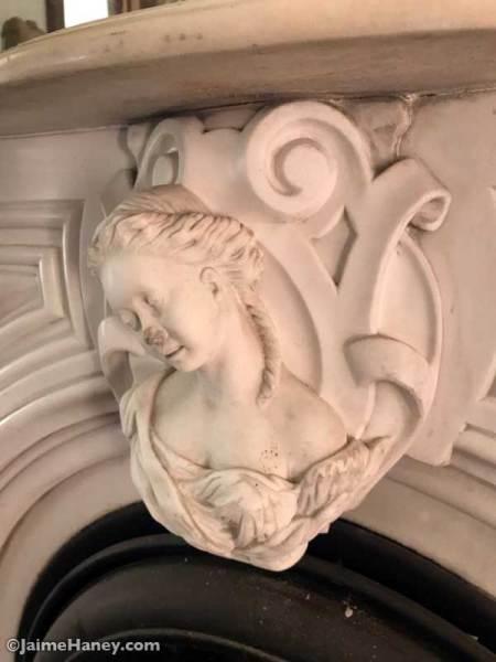 Carved marble female bust keystone