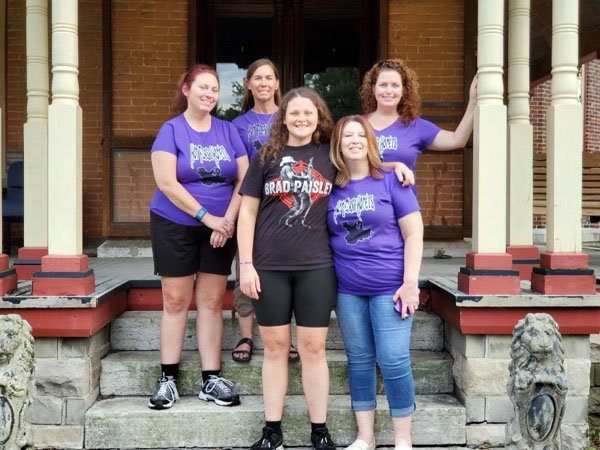 Hot Flash Honeys standing on front porch of General Asahel Stone Mansion