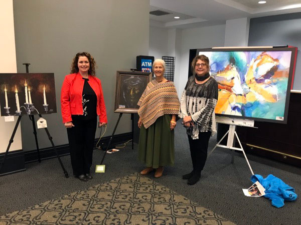 Jaime Haney, Sandy Dodd and Cynthia Watson with thier paintings