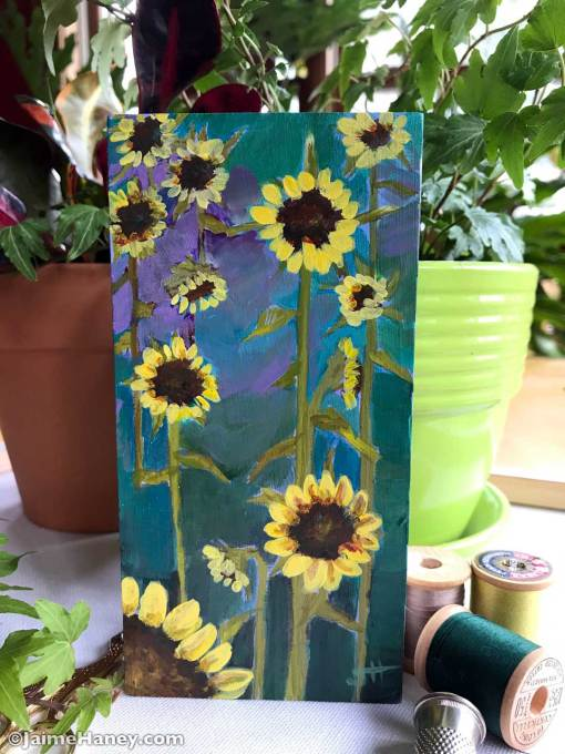 Abstract sunflower field painted on a small block of wood.