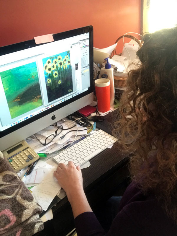 Artist Jaime Haney color correcting her images on the computer