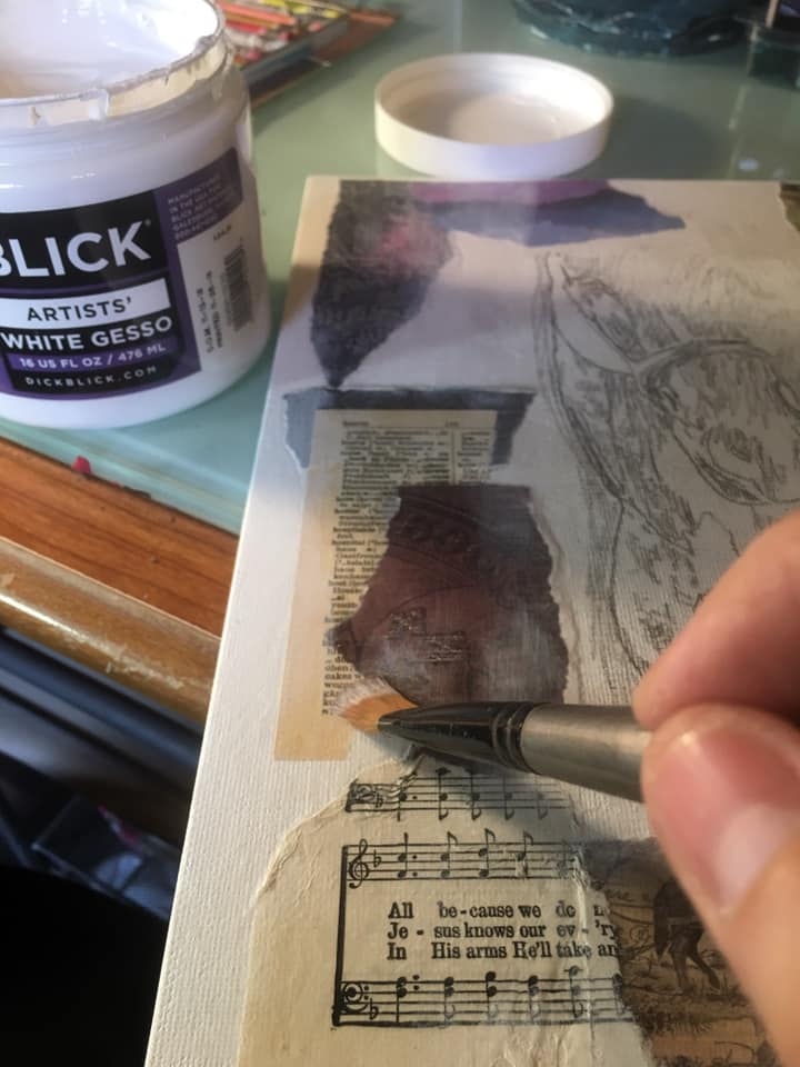 applying gesso with brush