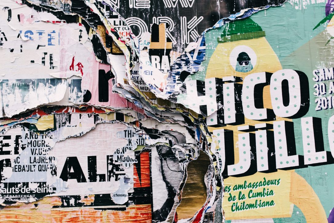 mixed media artist image Torn paper with words