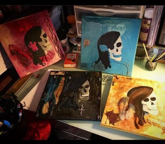 4 skull paintings