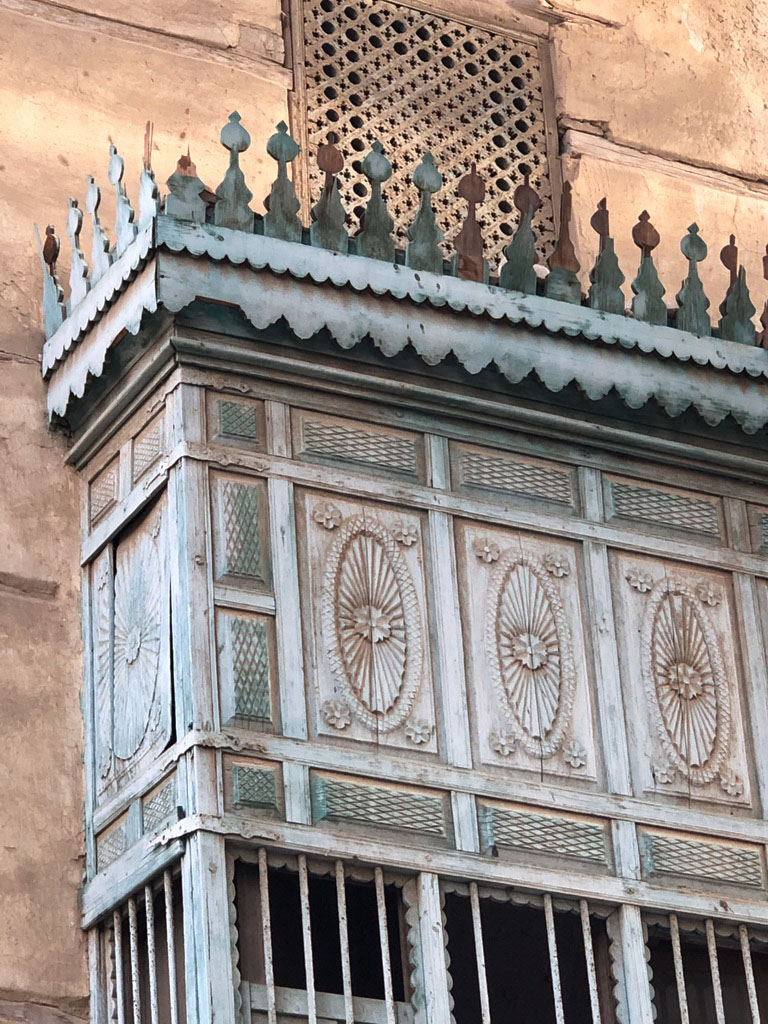 Blue painted wood latticework on mashrabiyah in Jeddah AlBalad Saudi Arabia