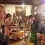 All of us enjoying gnocchi and wine.