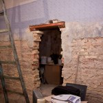 The wall is cleaned for insulation and we have a doorway to the future toilet!