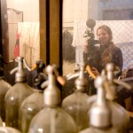 Old soda siphons and Barbara, director of the Jakab Gláser movie documenting everything