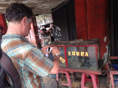 "Rand found interesting ""stuffs"" during our #JakartaWalkingTour: Chinatown. One of them was... A real live Cobra."