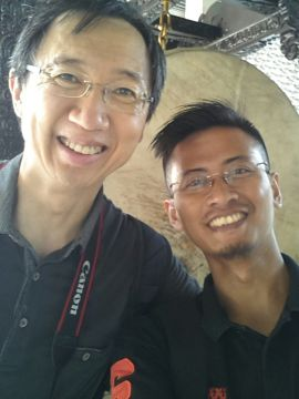 Dominic from Singapore with one of our guides, Huans, in front of a huge drum in Istiqlal Mosque.