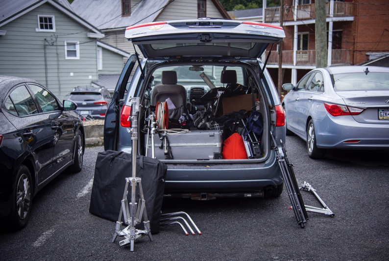 A car with its trunk open  Description automatically generated with low confidence