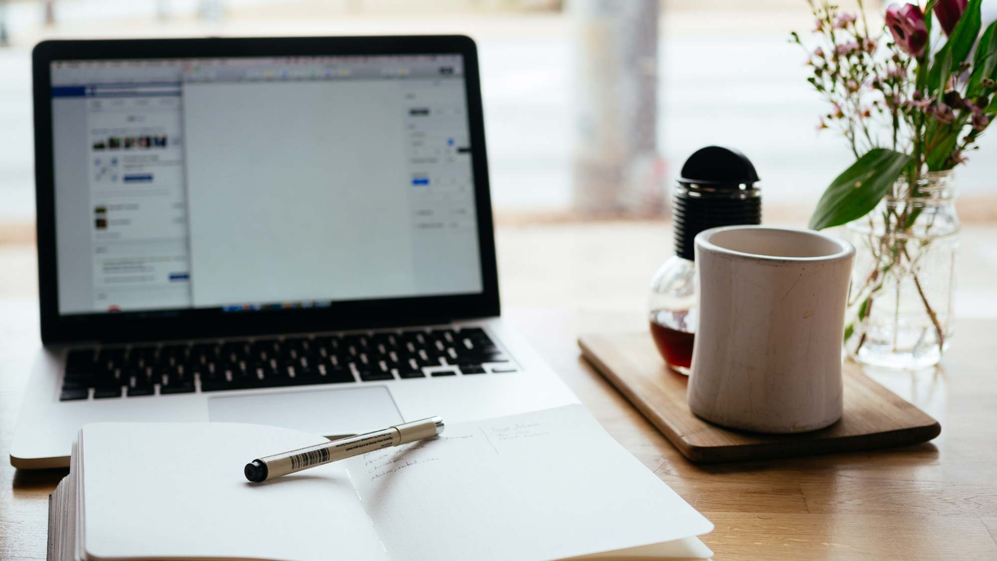 Journal, computer and coffee--all the tools to start writing! Photo by Nick Morrison on Unsplash
