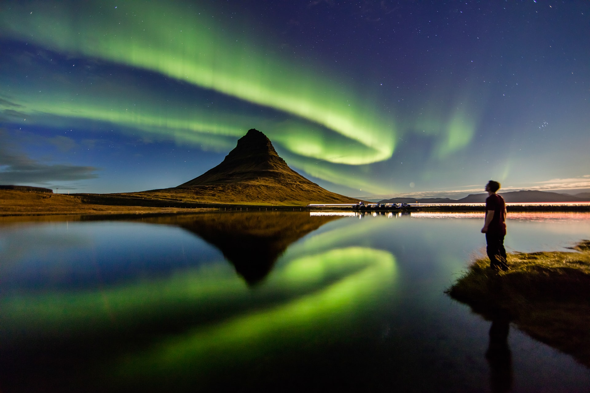 Aurora meeting in Kirkjufell, Iceland by Joshua Earle on Unsplash