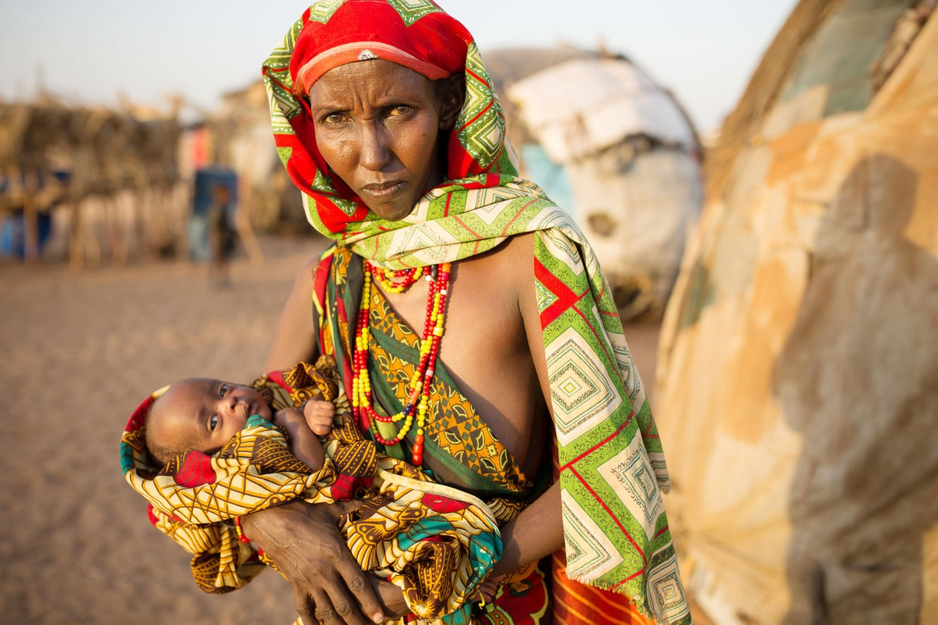 A Gabra woman holds her infant child in drought-struck Maikona County, Kenya.
