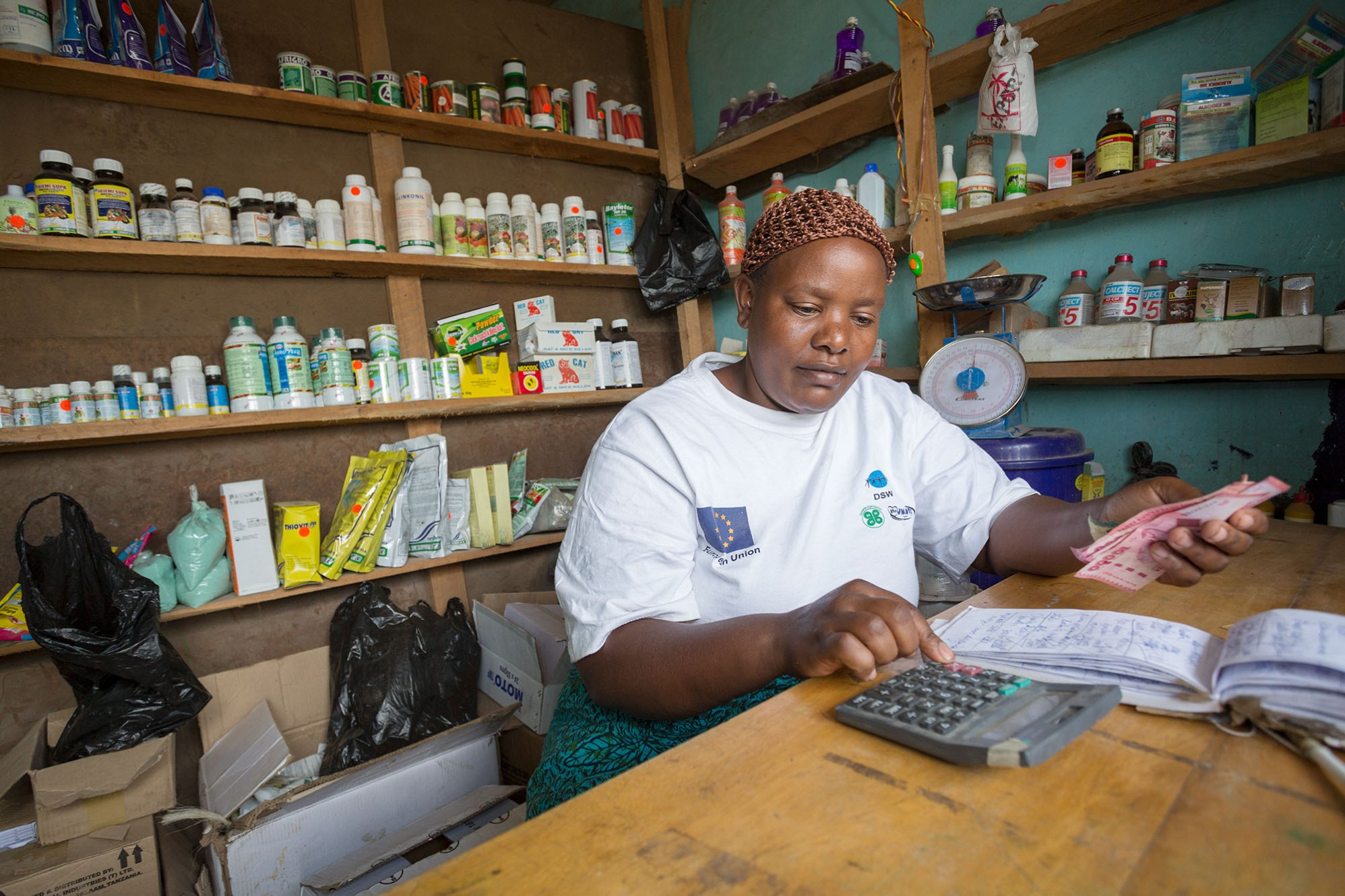 A woman works in an agricultural supplies shop in Arusha, Tanzania, East Africa.