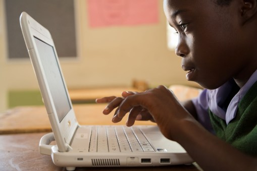A child learns on a laptop at a primary school in Nambia.