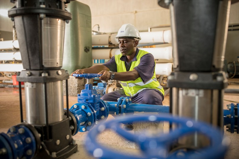 A worker operates a clean water pumping station in Cape Verde.
