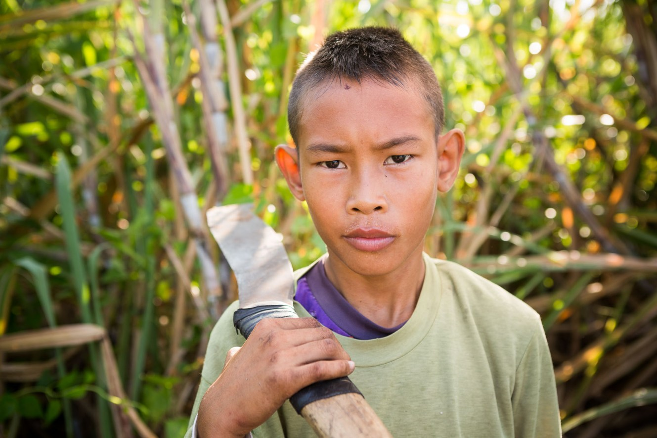 John-Michael (10) works daily in the sugarcane fields of Talisay, Philippines.